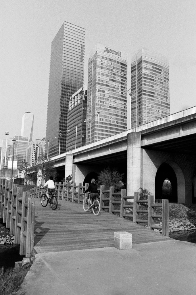 Biking over Foot Bridge shrunk